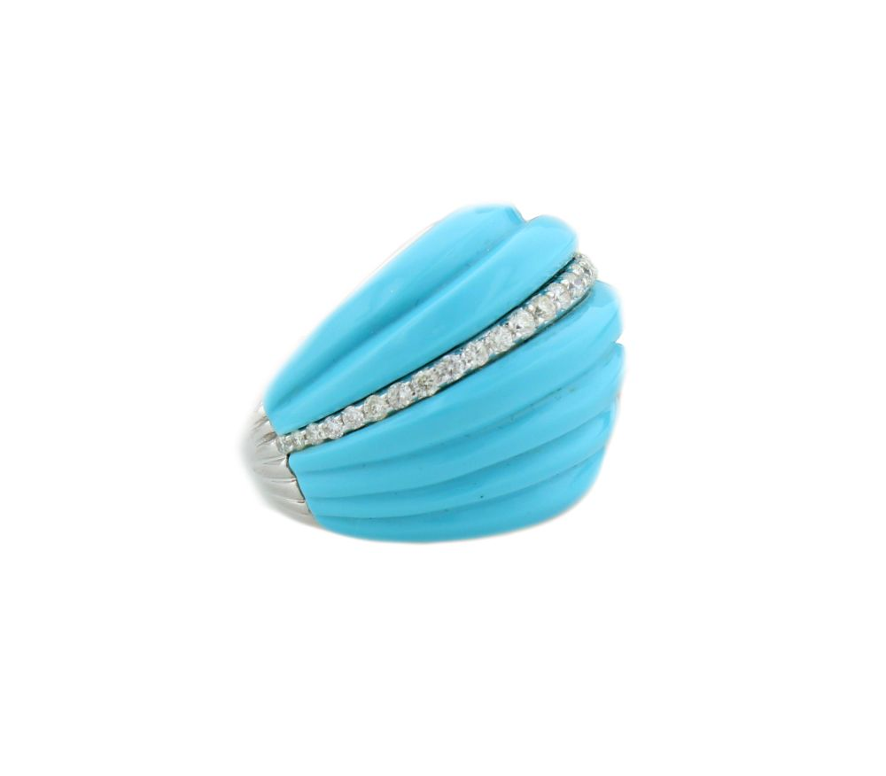 A dreamy piece of electrically-hued turquoise is encrusted with sparkling diamonds set as a ring in this modern dome shape.