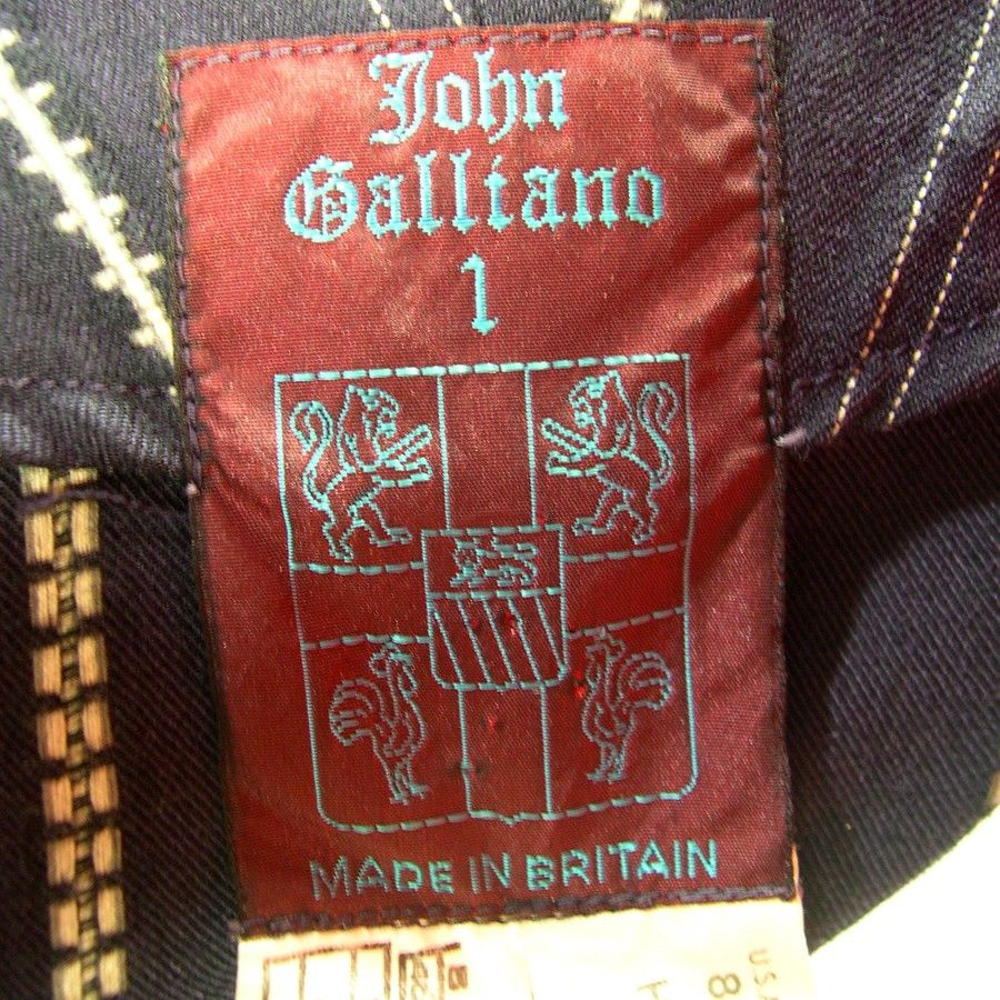 John Galliano edwardian inspired dress coat from his first RTW collection of 1984-London label. Intricate and cleverly tailored,this early piece illustrates perfectly the genius of Galliano's talents. +...