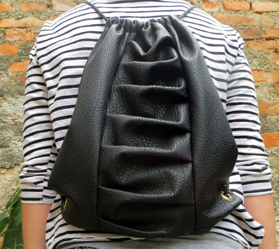 Unique mini backpack made of a faux leather. It is elegant and also sporty.  It looks something special. Backpack is unisex. This trendy bag is