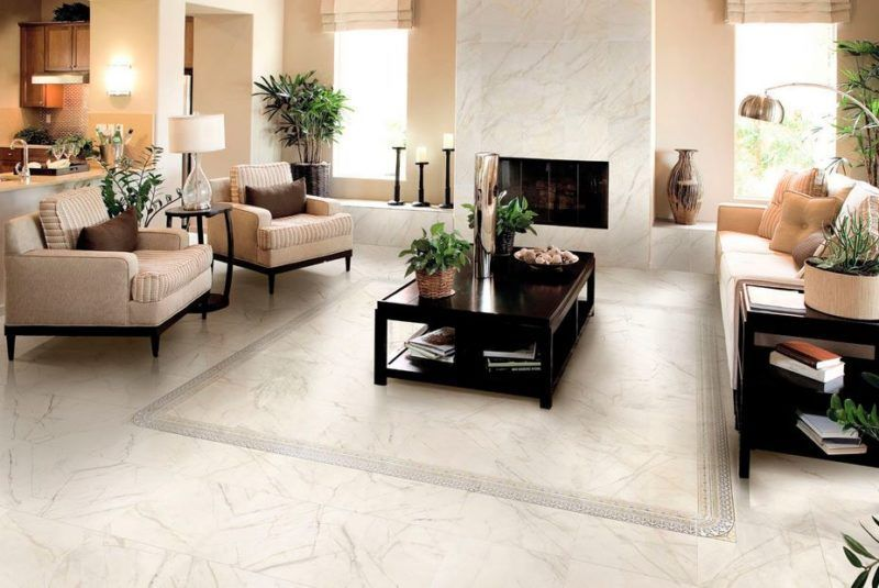 Contemporary Living Room With A Beige Sofa On White Marble Floor