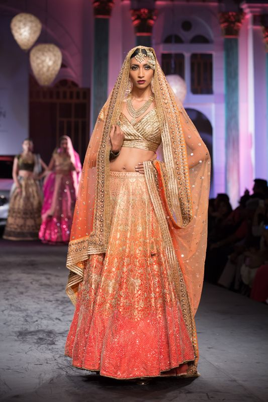 Elaborate peach gold orange Indian wedding lehnga by Meera Muzaffar Ali at India Bridal Fashion Week 2014. More here: http://www.indianweddingsite.com/bmw-india-bridal-fashion-week-ibfw-2014-meera-muzaffar-ali/