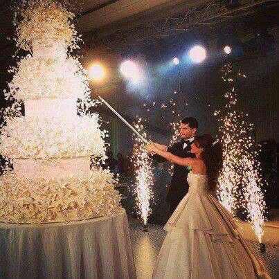 Fireworks and a sword to cut your wedding cake, that's some wedding! http://media-cache-ak0.pinimg.com/originals/fd/64/92/fd649260286dd84c3c827c6c64f10c19.jpg