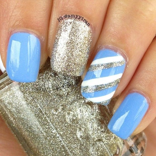 A combination of blue nails, a glitter nail, and a blue, silver, - A Combination Of Blue Nails, A Glitter Nail, And A Blue, Silver