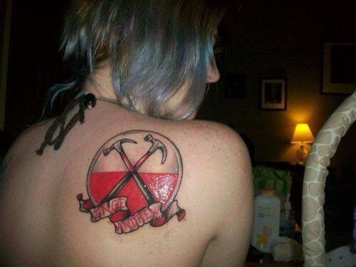 Pink Floyd Tattoo Duhh: Woman With Pink Floyd Hammers Back Tattoo