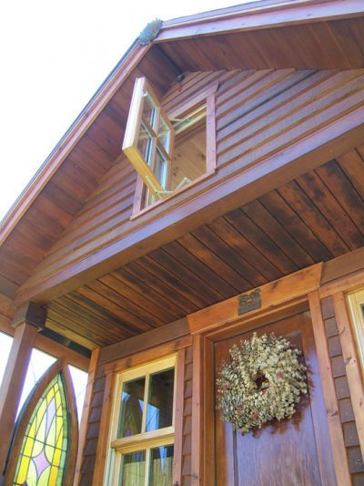 Love the stained glass hanging on the porch.