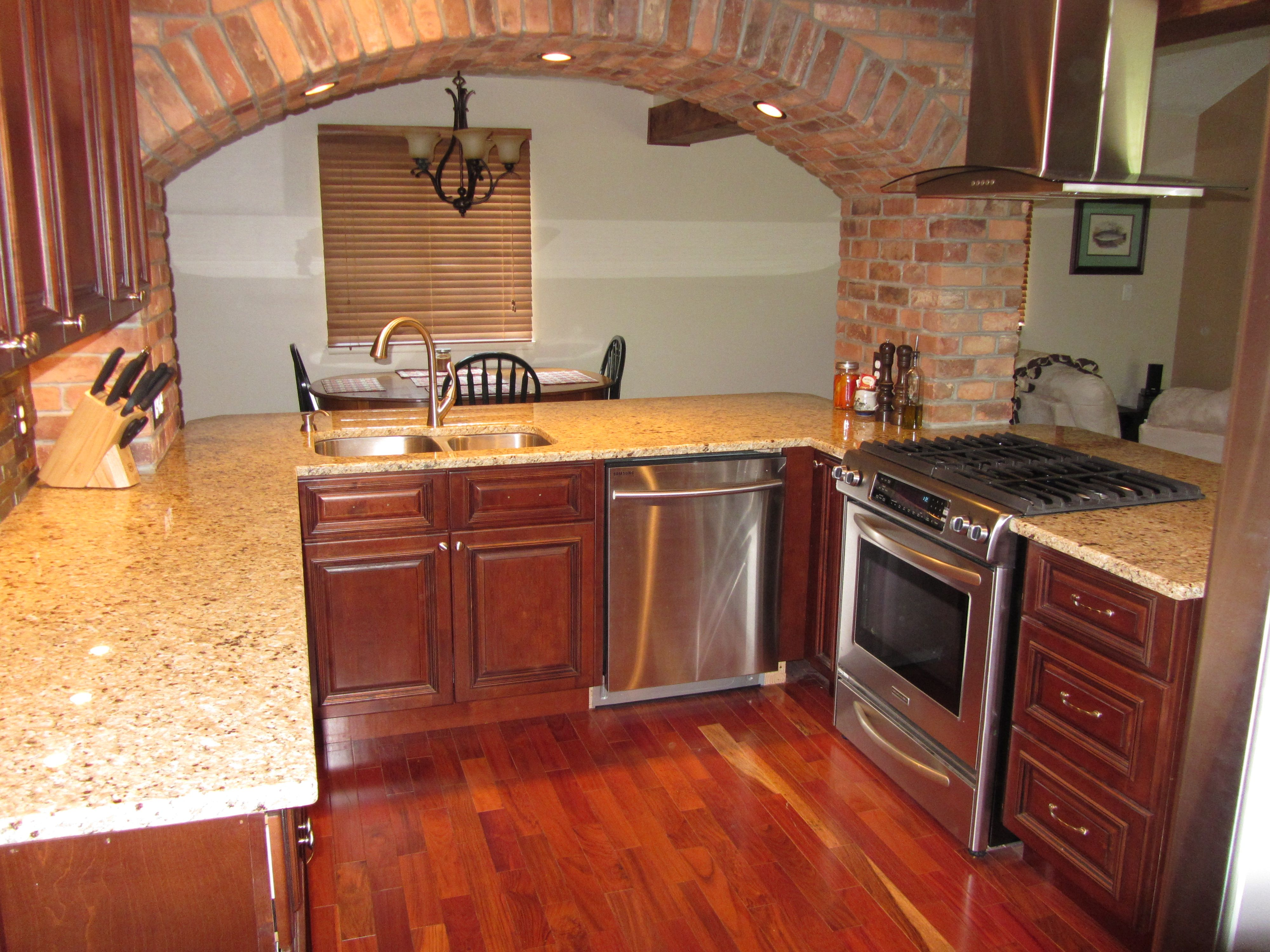 Rta Cabinet Store Brandywine Kitchen Cabinets With An Arched Pass Through To The Dining Room Kitchen Cabinets Maple Kitchen Cabinets Rta Kitchen Cabinets