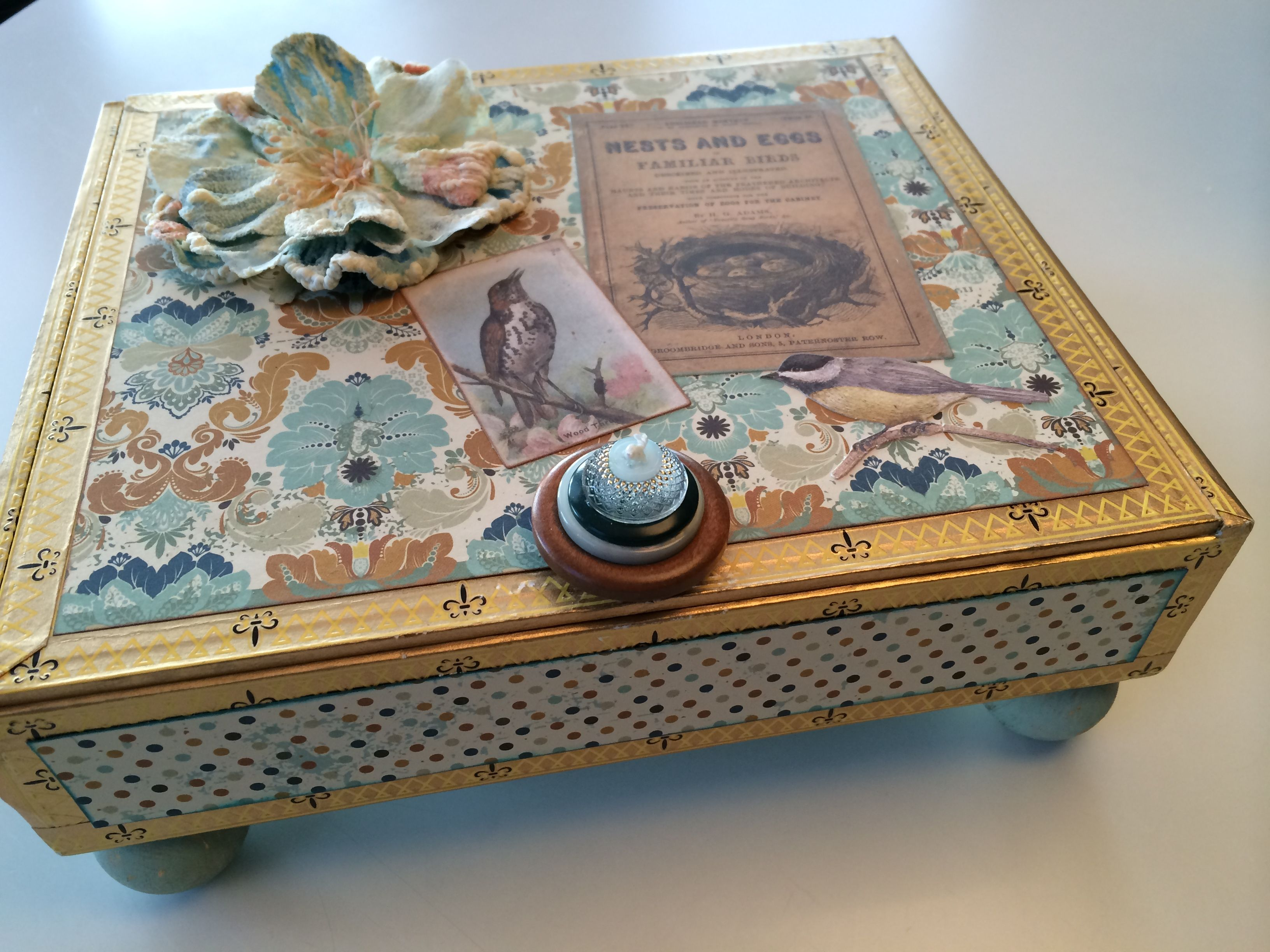 Altered cigar box by Rita Chiappetta with Kaiser Craft Papers