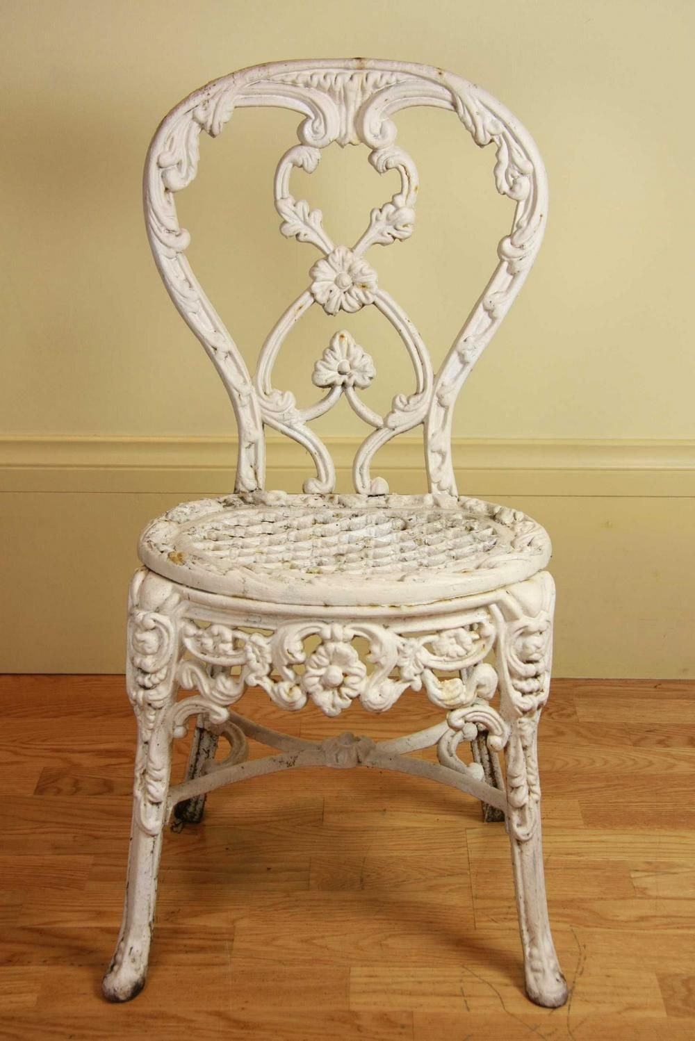 A French wrought iron ladies garden chair, circa 1850, the…
