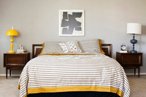 Yellow + gray + stripes. Love the nightstands. Just want to straighten the lampshade on the right!