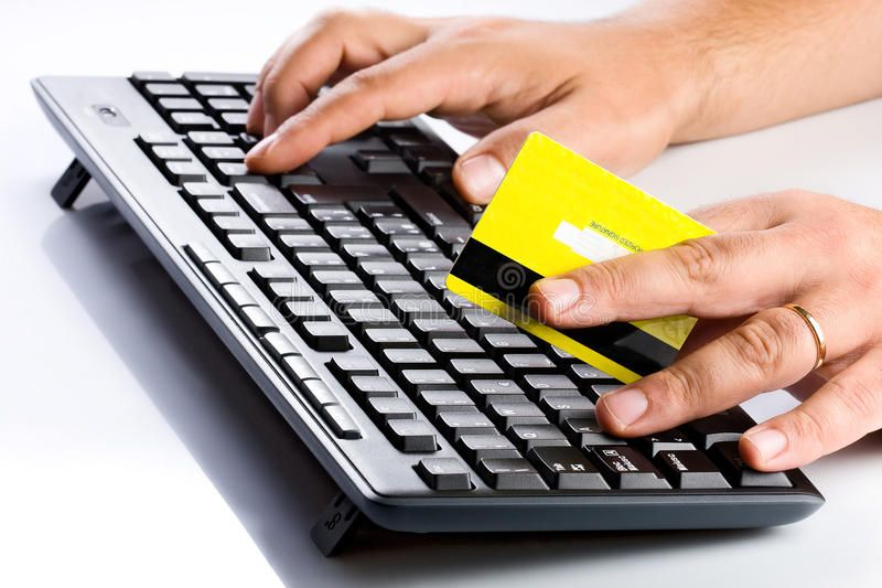 Keyboard and credit card online shopping buyer holding