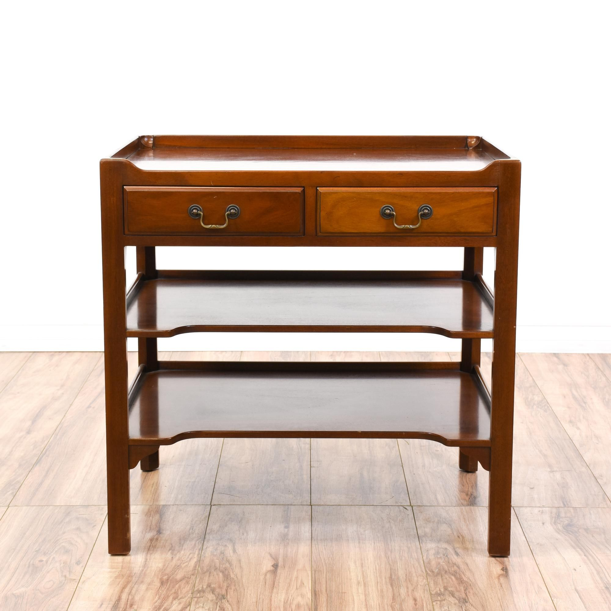 This Asian style side table is featured in a solid wood with a