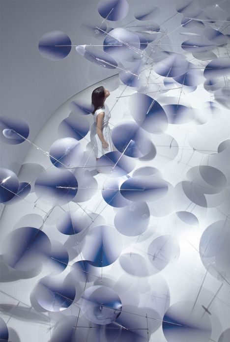 Moving plastic petals balanced in Interconnection installation by Nao Tamura #Milan14