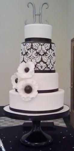 Black and White Damask Wedding Cake with Edible Flowers - what is with this rediculous monogram trend; it ruins the cakes!!!!!