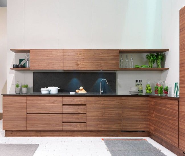 La Cucina, Matteo Thun's simplified kitchen for Riva 1920, is made only of walnut (no visible hardware)   designlinesmagazine.com