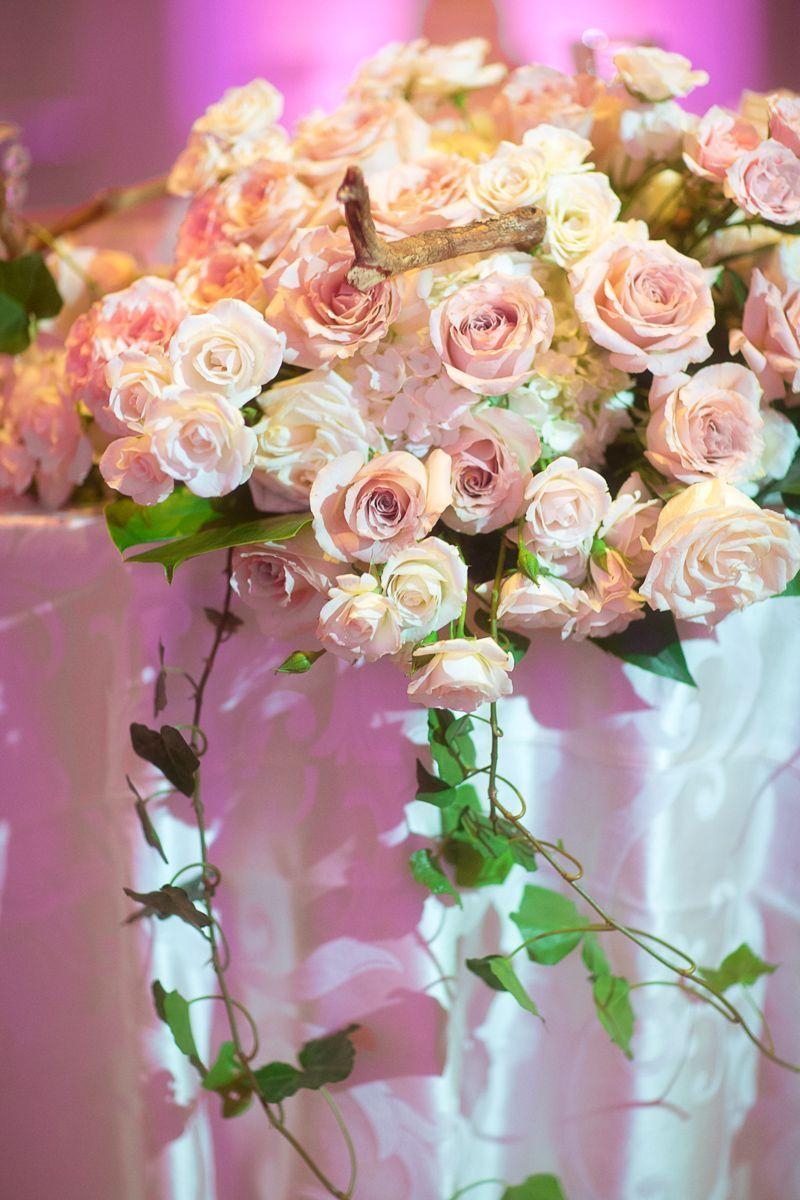 Beautiful centerpieces setup at this pink, uplighting wedding reception !