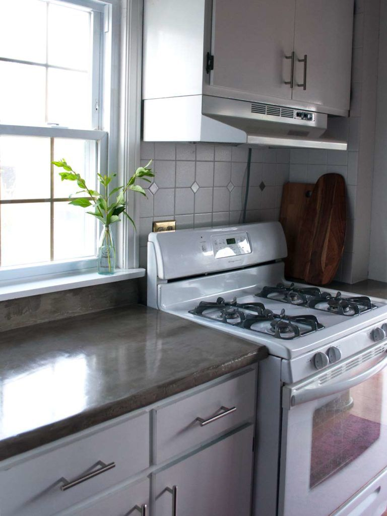 Feather finish concrete over tile counters and then we