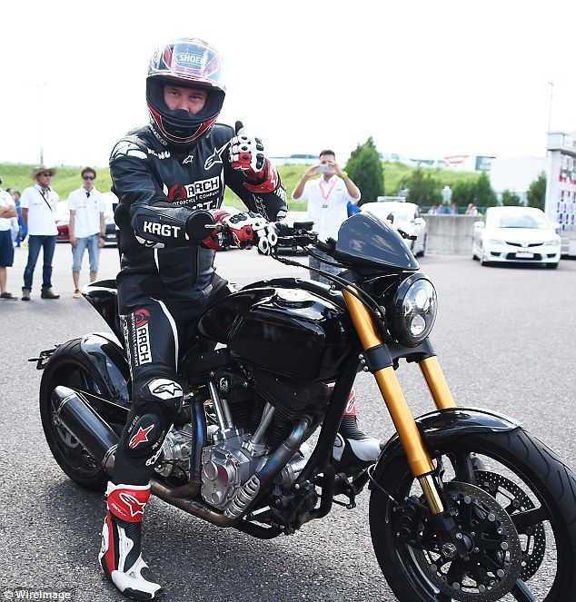 Suited up: The Constantine actor gave the thumbs up as he put his helmet on for the Suzuka 8 Hour FIM Endurance world championship, Sunday, 26 July 2015