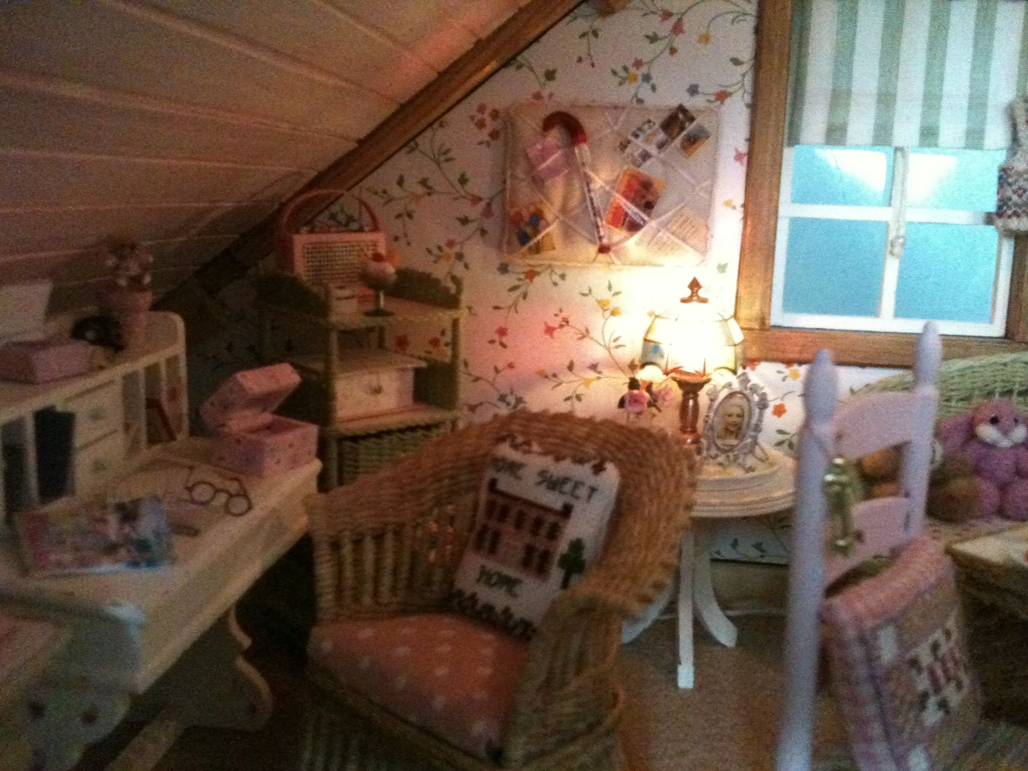 a view of my dollhouse cottage workroom / bedroom