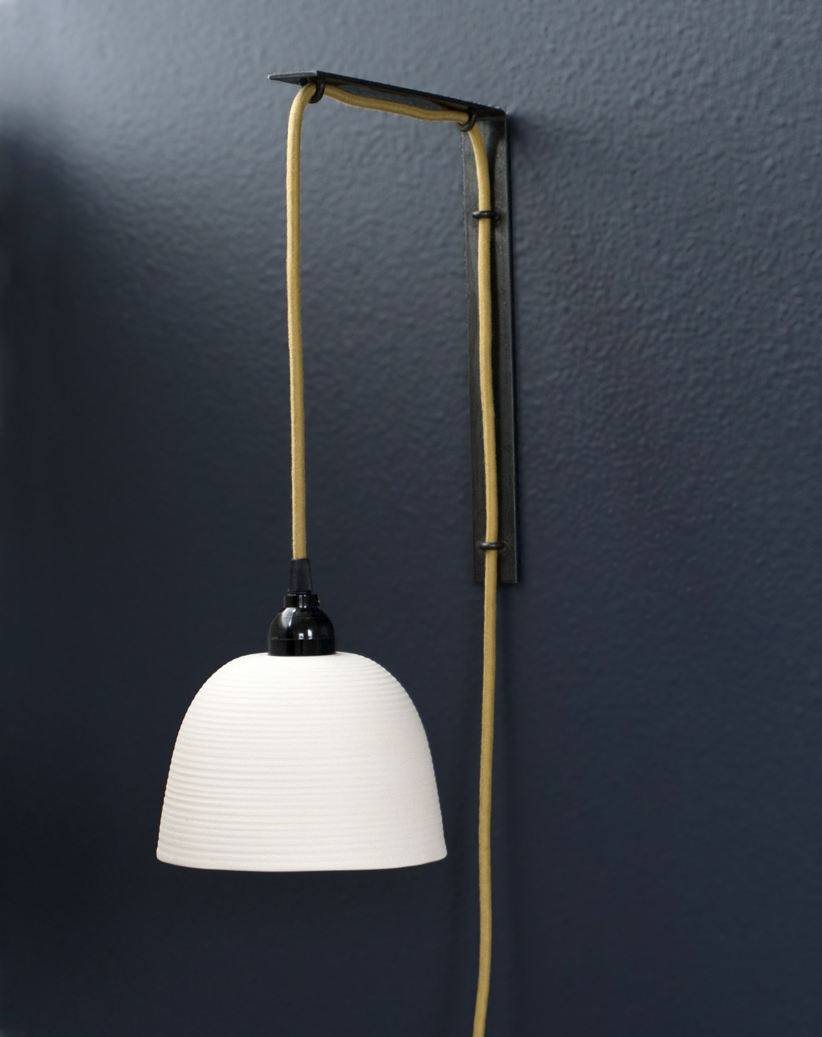 This Wall Mounted Pendant Sconce Is Suspended By A Curry Colored Cloth Cord Threaded Through A Locally Made Steel Bracket Pendant Sconce Sconces Ceramic Lamp