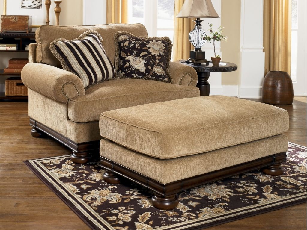 I would love to have a pair of these chairs ottomans for my tv room in place of the recliner sofa honey