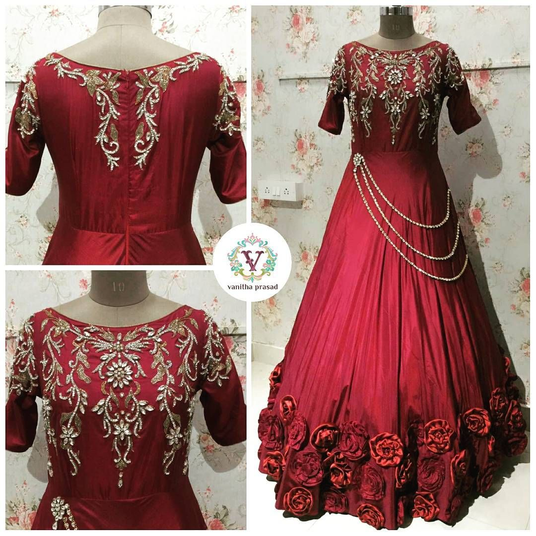 A bridal affair beautiful maroon color long bridal gown with lotus