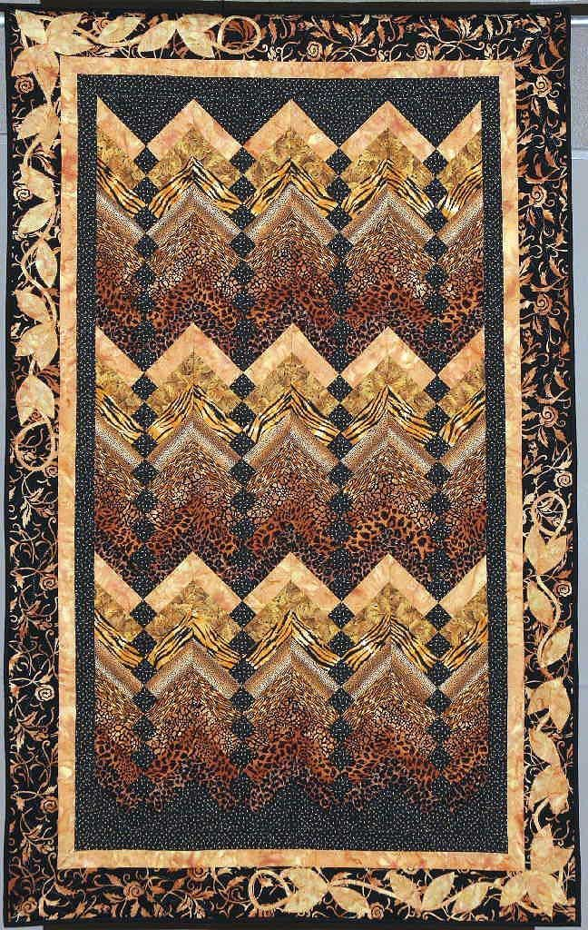 A French Braid quilt with animal-print fabrics, with a color wash ... : animal print quilt patterns - Adamdwight.com