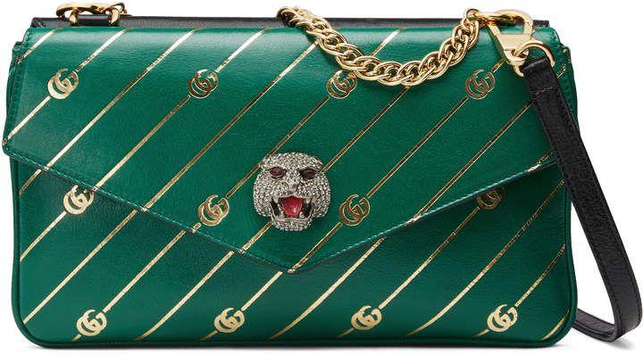46944ba7e6fd GUCCI, $2,890 - Medium double shoulder bag - Gold Double G stripe print green  leather