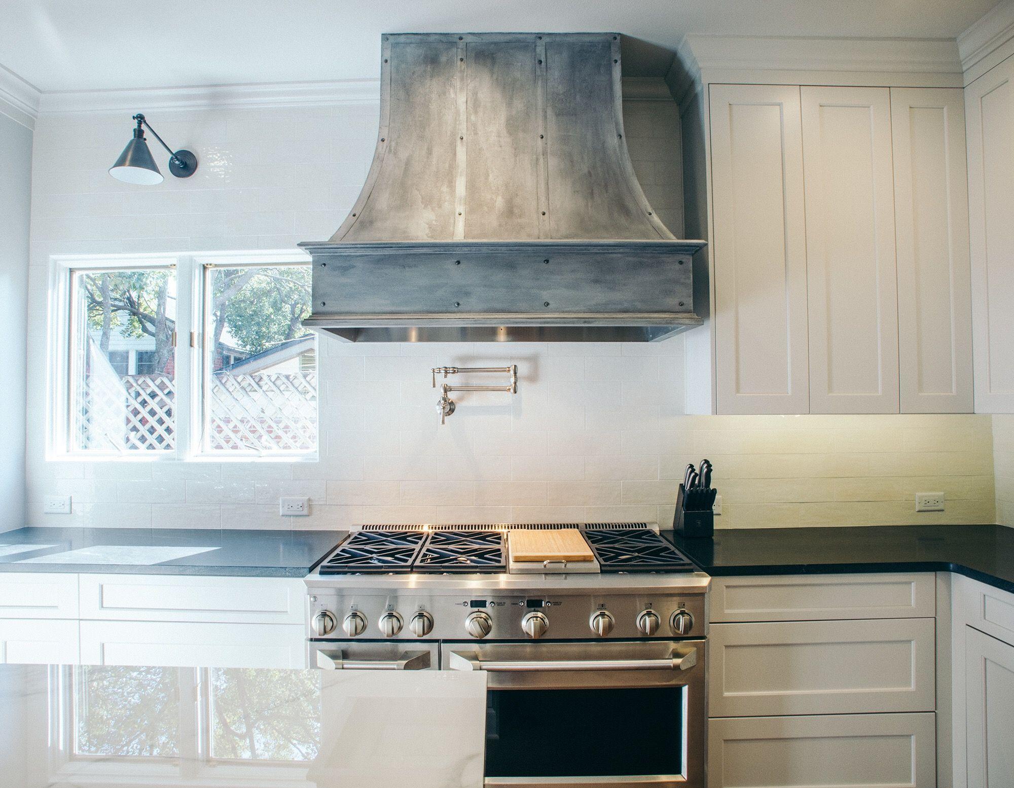 Custom pewter, plastered range hood. We used venetian plaster ... on metal panels, metal decks, metal vinyl, metal barns,