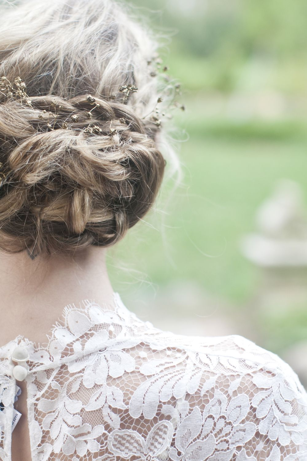 Lovely braided wedding hair with tiny flowers and a lace top wedding