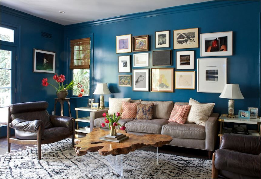 Deep Blue Walls + Art Collection Above Sofa