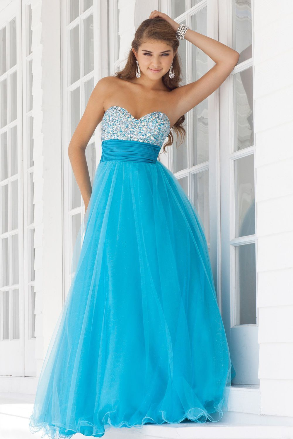 Sparkles at the top of the dress is so pretty! I would wear this as ...