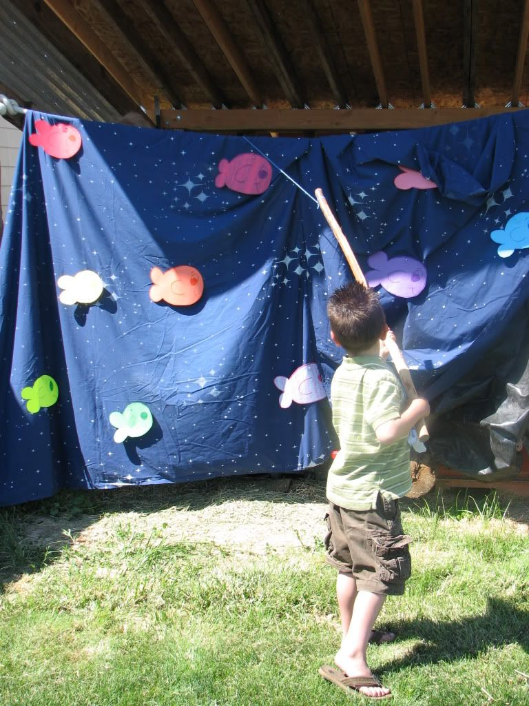 mystery fishing game sheet hanging over a clothesline totally