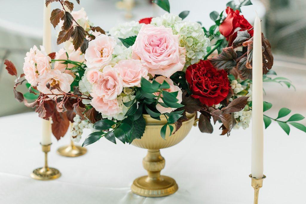 Gold urn centerpiece blush and burgundy wedding