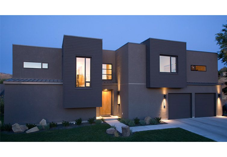 Exterior view of the front of the house at twilight for Modern house front view
