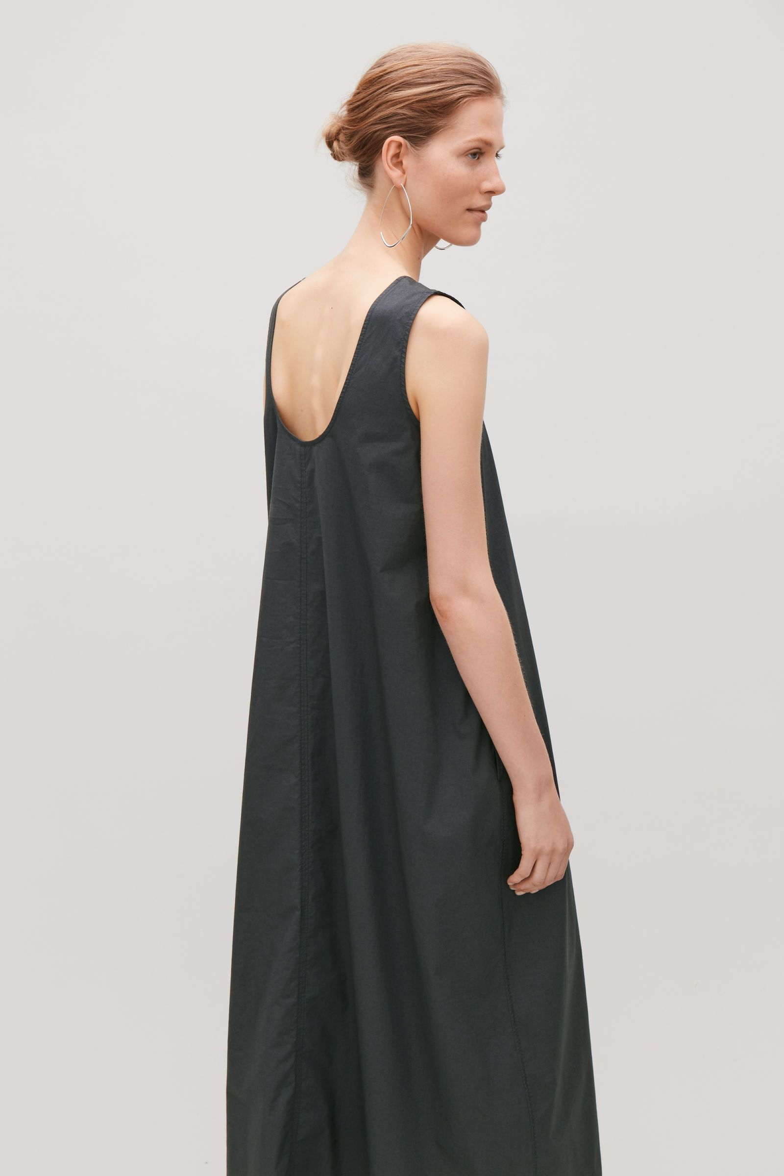 879ab179db Model side image of Cos sleeveless balloon dress in grey