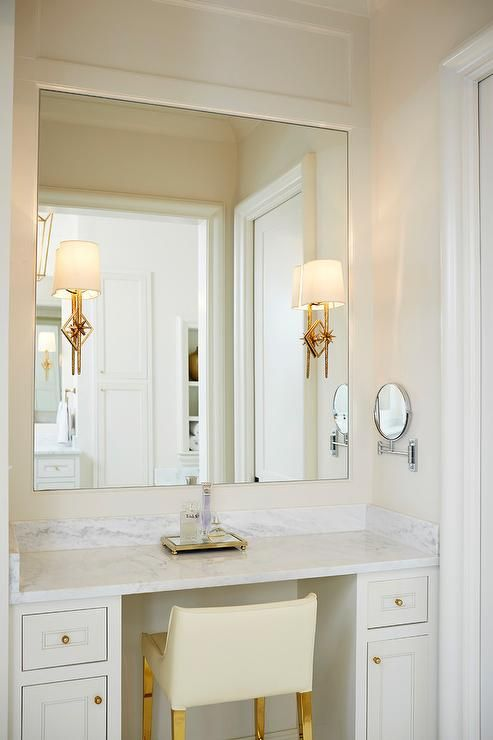 Lovely White And Ivory Bathroom Features An Ivory Leather Stool On Gold Legs Placed At A White B Built In Vanity Bathroom With Makeup Vanity Master Bath Vanity