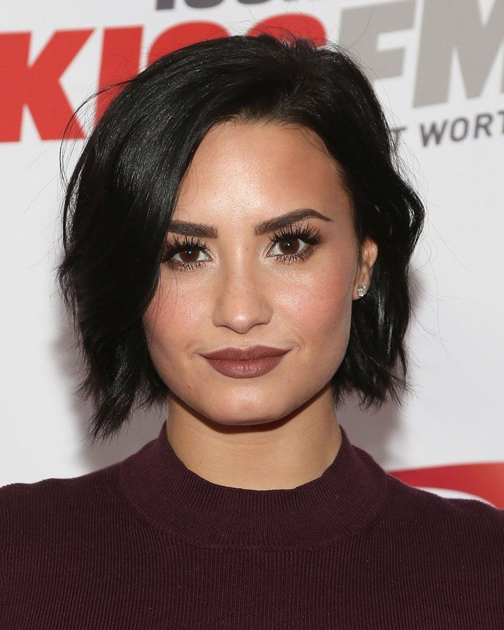 Pin for Later: Demi Lovato Just Owned the Jingle Ball Stage in Red Leather Booty Shorts