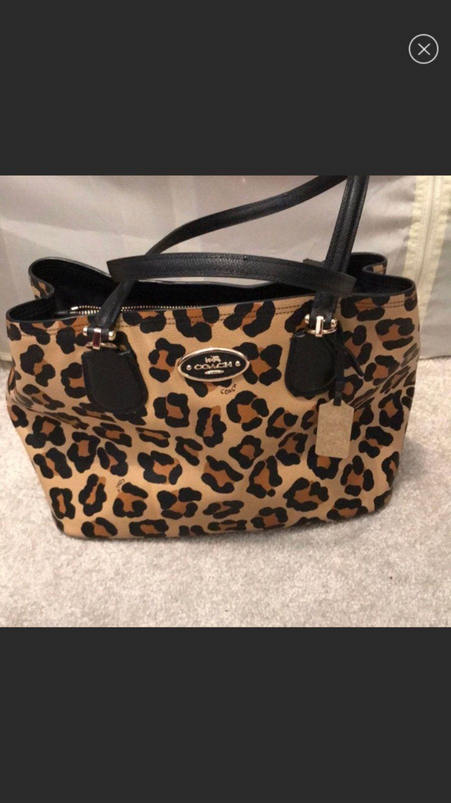 beige and black leopard Coach tote bag in Columbia letgo