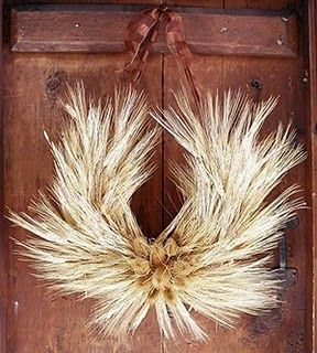 Wheat Horseshoe Wreath...wheat is a symbol of fertility...had one of these at my wedding and it worked like a charm...honeymoon baby!  ;)