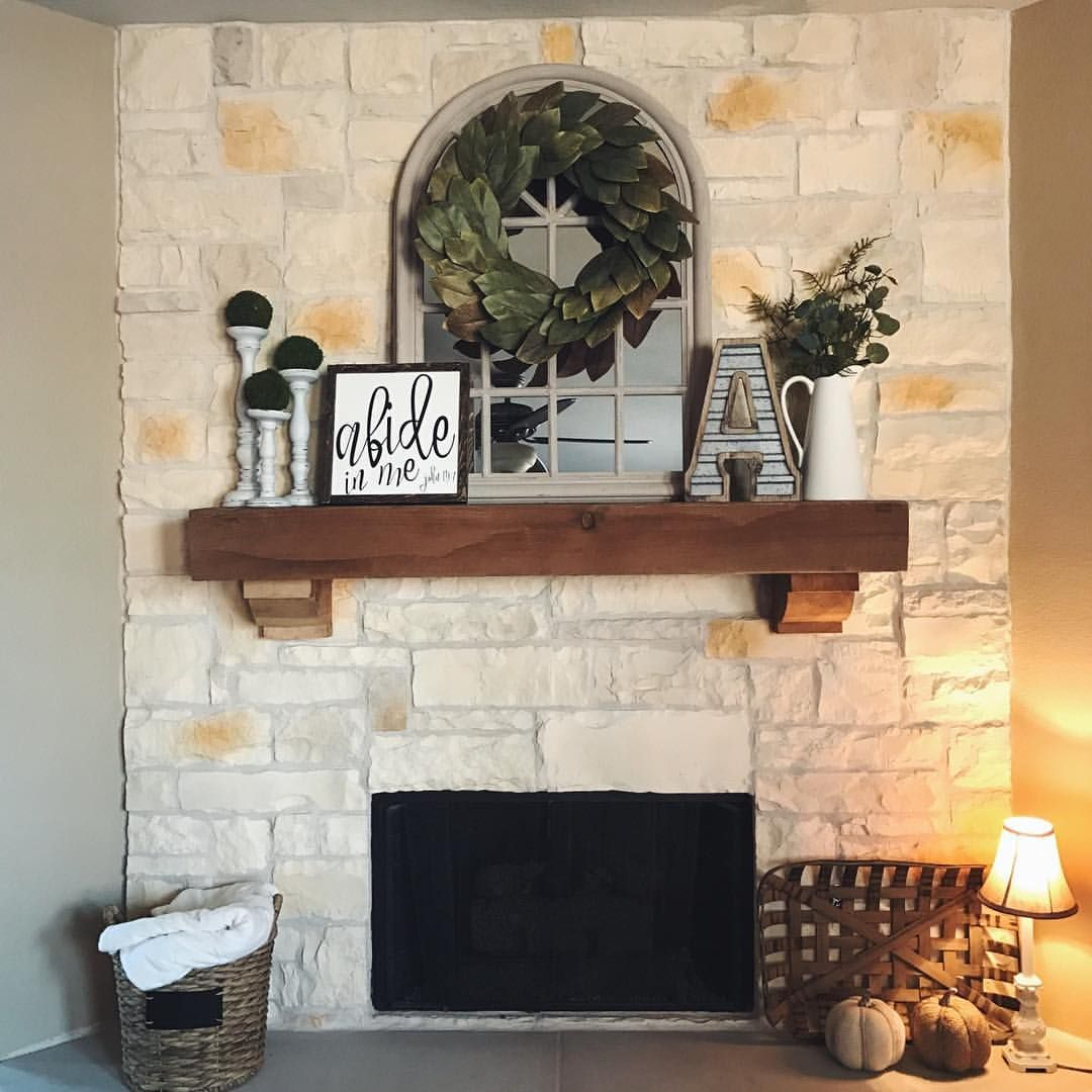 Farmhouse mantel with magnolia wreath tobacco basket see for Farmhouse fireplace decor