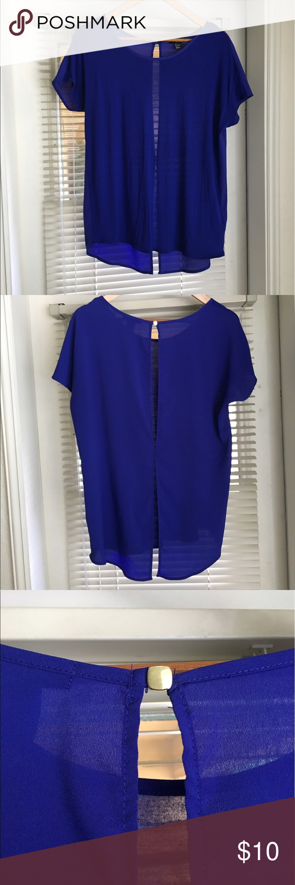 Express open back top blue shirt with cotton blend front and open