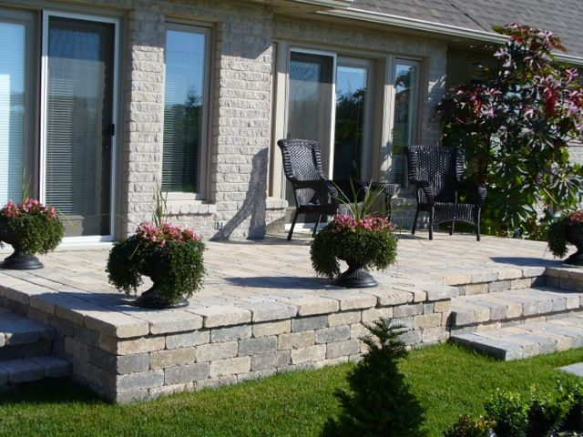 Raised Patio When We Redo The Back Deck This Would Be Great Raised Patio Concrete Patio Designs Patio Stones