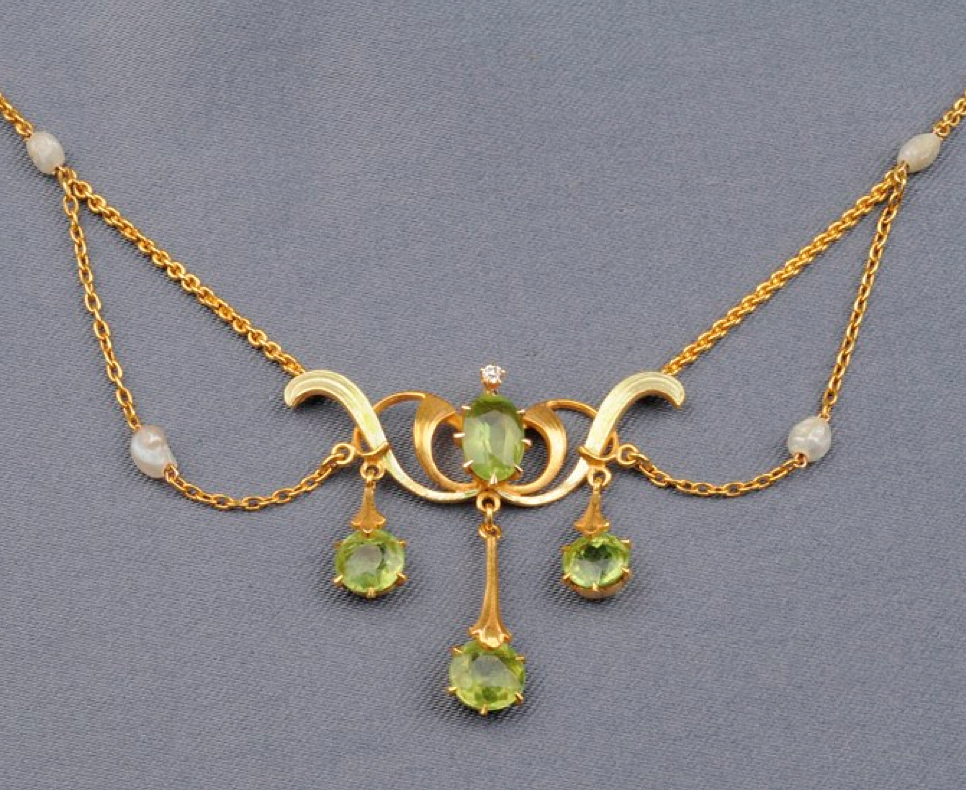 Art Nouveau 14kt Gold, Peridot, Freshwater Pearl, and Diamond Lavaliere, set with cushion and circular-cut peridot, old European-cut diamond highlight, the festoons with freshwater pearl accents