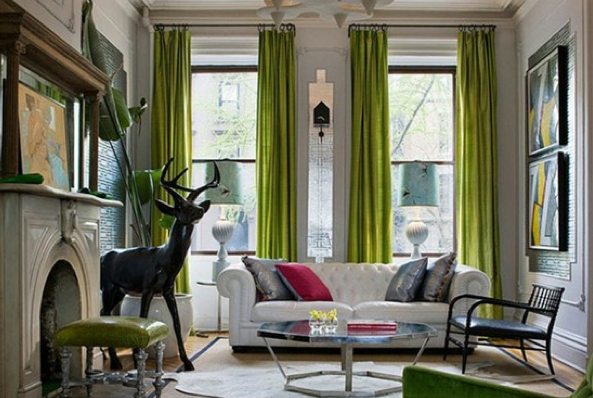 white? gray? walls, gorgeous bright green drapes, ivory chesterfield sofa. and a giant deer.