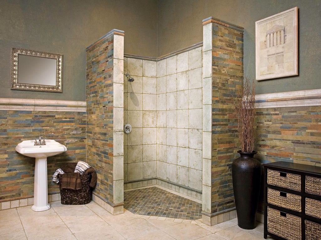 The color scheme and tile selection in this bathroom is amazing ...