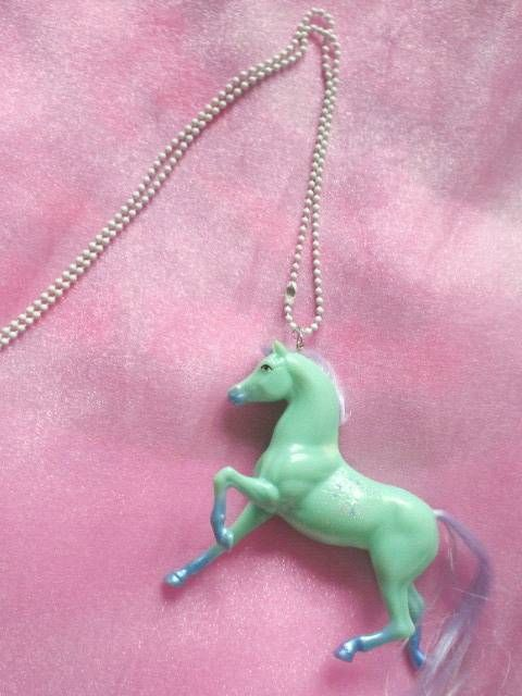 Check out this totally rad horse necklace. This would put fear in the hearts of anyone who sees this around your neck, not because of the necklaces' giant dog-like anatomy, but because you went out of your way to buy this arrangement online and have it shipped to you because you care about how it looks so god damn striking.
