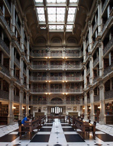 BaltimoreThe library's interior is what most visitors find captivating—five book-filled floors with cast-iron balconies encircling a central atrium where, if you're lucky, you can pull up a chair at one of the reading desks. The skylight 61 feet above allows sunlight to spill onto the black-and-white black-and-white marble floor.