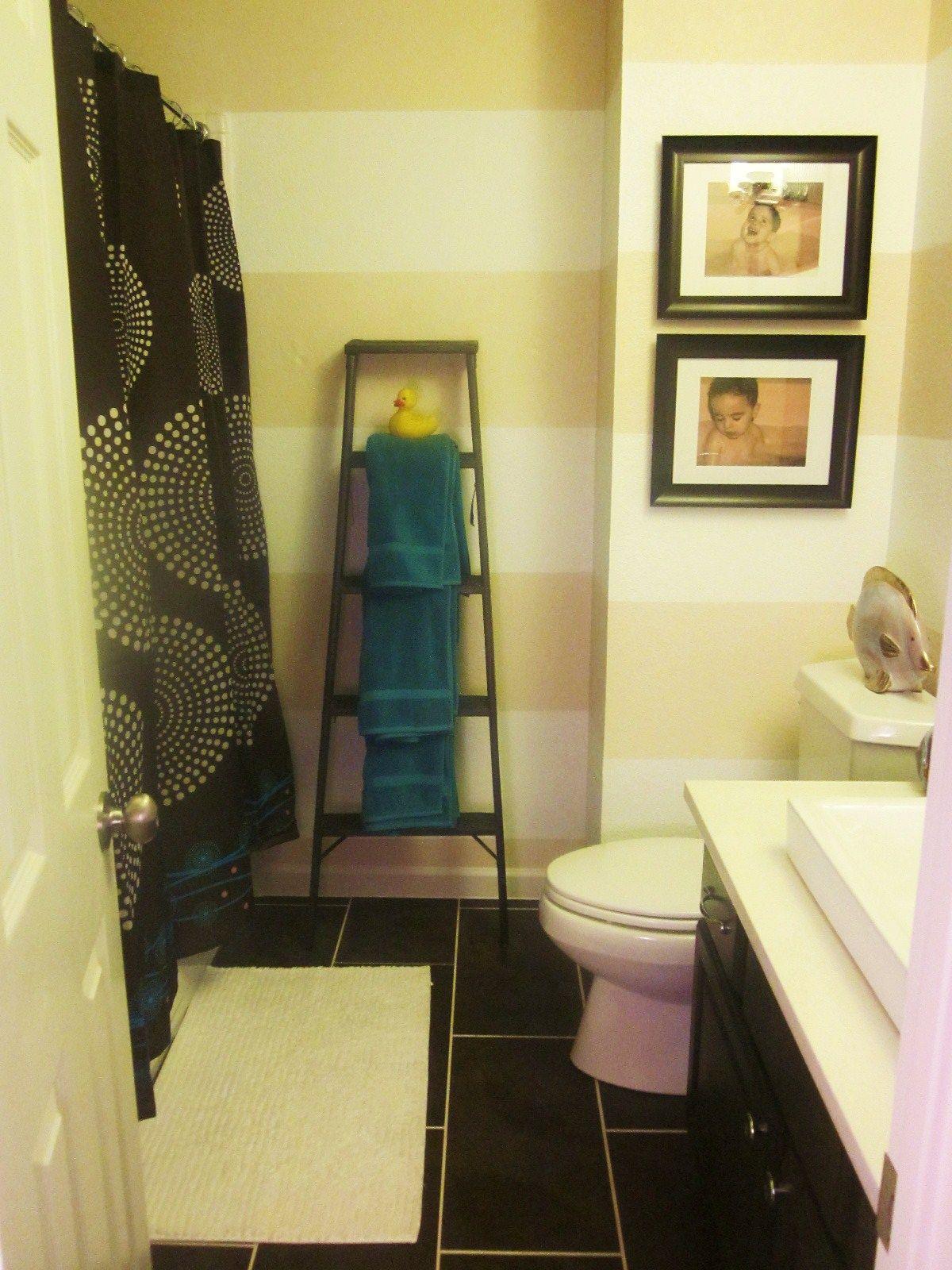 Stripes on bathroom walls and dark floor. | Bathroom Ideas ...