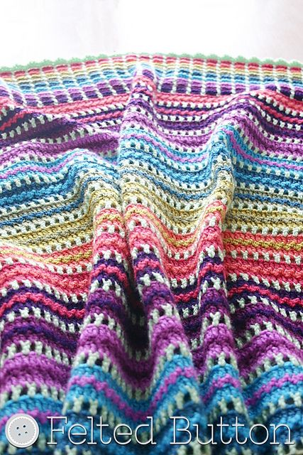 This amazingly beautiful blanket it's so easily done using simple stitches: sc, hdc and dc. Skittles Blanket by Susan Carlson with an amazing design and a stunning border, surprisingly enough, is an easy to crochet pattern. Susan Carlson's style and use of color are so perfect, this blanket will get you excited to start on …