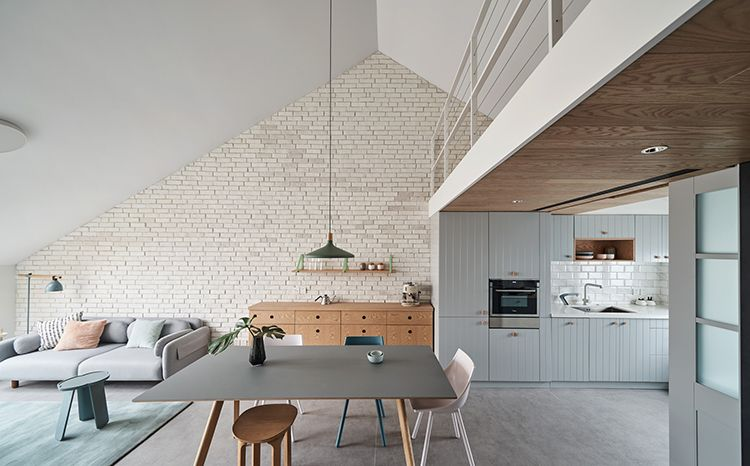 HAO Design Uses Pastel Hues For Slopedceiling Apartment